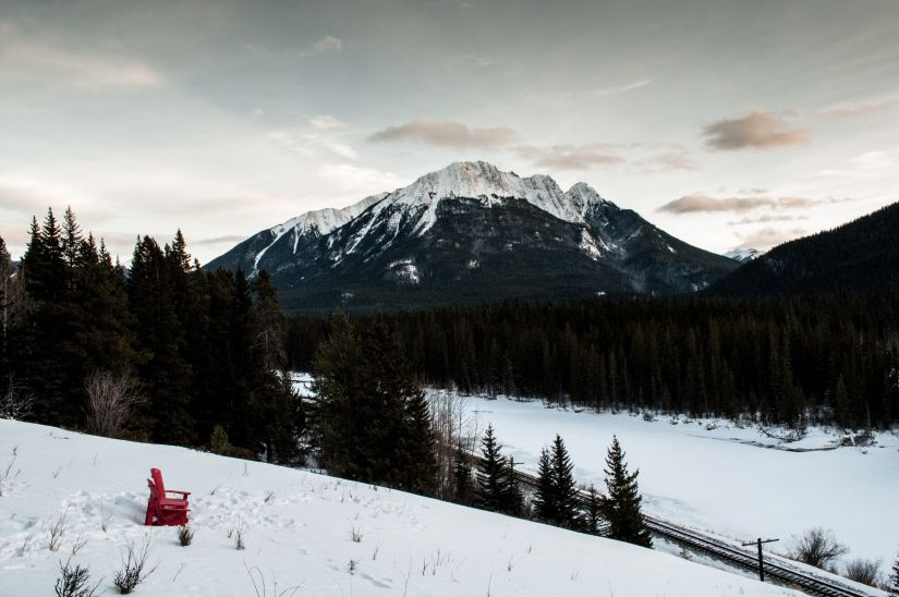 Chair overlooking mountains Alberta Canada