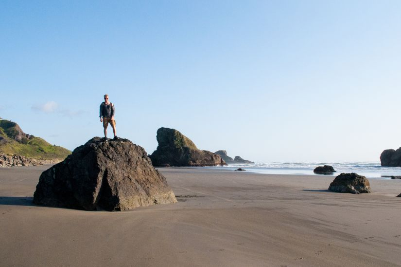 Jenya on a big boulder on the Oregon coast